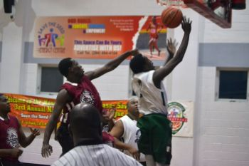 Frankly L. Penn Junior, seen here going for a layup, finished with a game high 35 points. Photo: Charlie E. Jackson/VINO