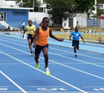 Kybar Dawson takes a victory in the Inter Primary School Track and Field Championships concluded on Friday March 11, 2016. Photo: Charlie E. Jackson/VINO