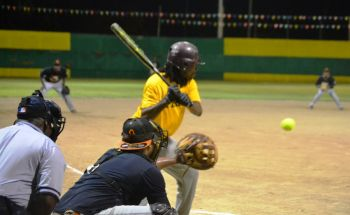 A batter preparing for a pitch. Photo: Charlie E. Jackson/VINO
