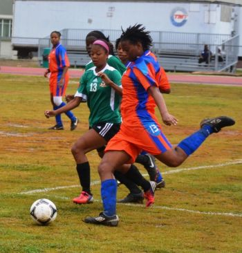 Roxanna Bradshaw and Brittany Lawrence tussle for the ball during Anguilla's 2-1 win over St Kitts/Nevis. Photo: Charlie E. Jackson/VINO