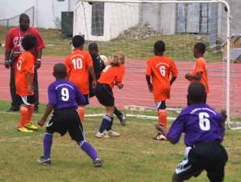 Requan Garraway scored from a free kick to pull a goal back for Pelican Gate/Alexandrina Maduro U9's, but a Jalen Prentice hat trick secured the points for First Impressions. Photo credit: Charlie E. Jackson/VINO