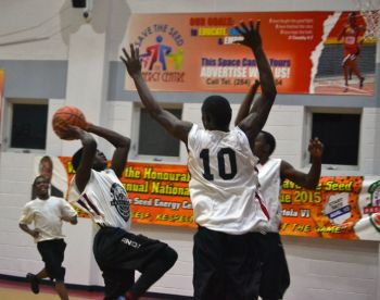 Young Starz and Pure Playaz in action in the Hon Julian Fraser Save the Seed Basketball League on August 30, 2015. Young Starz won 83-55. Photo: Charlie E. Jackson/VINO