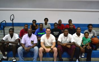 Kevin Carragher of Digicel (BVI) sits with the Bayside Blazers team after motivating them with the importance of team work. Also in picture is Blazers' manager Julian Willock (@ Carragher's immediate right) and coaches Jason A. Edwin and Rhennie O. Phipps. Photo: Charlie E. Jackson/VINO