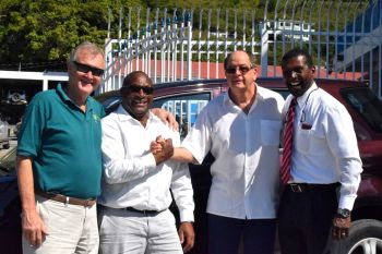 Alan E. Parker (2nd from left) of VI Motors has partnered with the BVIFA to provide Marcos Falopa with much needed transport. Photo: BVIFA