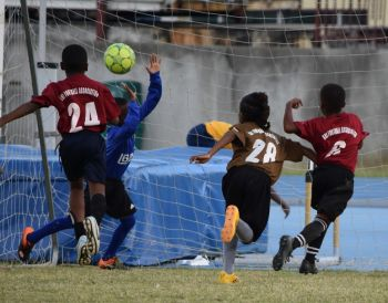 Latriel Williams scores for ASPS in the 1-0 win over Robinson O'Neal in the U9 Final. Photo: Charlie E. Jackson/VINO