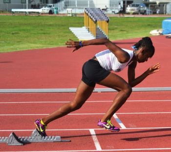 Judine Lacey was an U15 Girls 200/400m winner. After running 59.36 seconds in the 400m prelims, she won in 1:00.53. She then took the 200m in 25.96 to Zakaria Frett's 26.44. Photo credit: Charlie E. Jackson/VINO