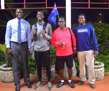 Among those that turned up to welcome Kyron A. McMaster and coach Dag Samuels were Minister for Education and Culture Myron V. Walwyn (AL), left, and President of the BVI Athletics Association Steve Augustine, right. Photo: Charlie E. Jackson/VINO
