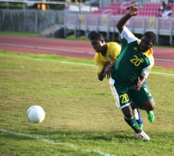 Action between St. Vincent and the VI in the recent BVI Football Association's 40th Anniversary celebrations. Photo: VINO/File