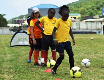 Going through their paces at the CONCACAF World Women's Day event at the A.O. Shirley Recreation Grounds. Photo: Charlie E. Jackson/VINO