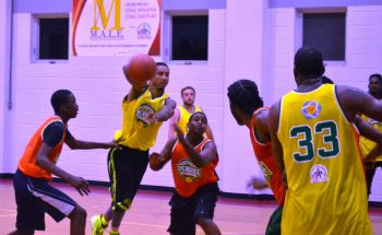The second game of the night featured the American coaches, who had been presenting at the Camp and a Tortola XI. They scored a 20 point blow out, 124-104, despite the efforts of the younger Tortola players who were definitely out to impress. Photo: Charlie E. Jackson/VINO