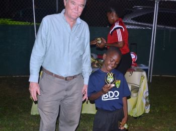 U9 MVP Joel Mars of Bregado Flax Educational Centre admires his trophy alongside President of the BVI Football Association, Mr Andy Bickerton. Photo: Charlie E. Jackson/VINO