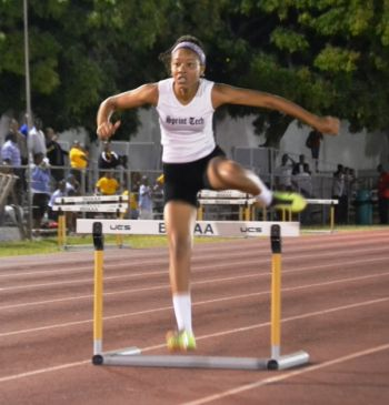 Running solo, Deya Erickson made qualifying times for both Carifta and CAC's, but due to a lack of entrants in the 100m Hurdles, it's up in the air as to if the time will stand. IAAF rules apparently demand at least 3 entrants per event. Photo: Charlie E. Jackson/VINO