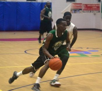 A West Gunners player gets past Dione M. Blyden of Bayside Blazers. Photo: Charlie E. Jackson/VINO