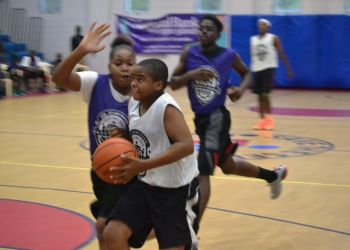 Keshawn Esprit of Swaggas attacks the basket during the game against Junior Avengers on Sunday September 13, 2015. Photo: Charlie E. Jackson/VINO