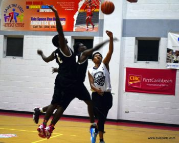 Starz (black) overcame their more young opponents Community One 95-51. Photo: Charlie E. Jackson/VINO