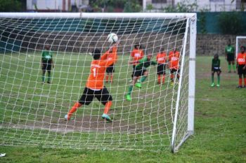 Jerome Parkins put a stop to any St George's come back with a penalty save from Michael Palladino as First Impressions ran out 7-0 winners in the semi final clash. Photo: Charlie E. Jackson/VINO