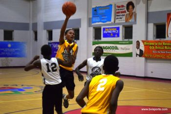 Young Stars (yellow tops) were defeated by High Speed, 27-29. Photo: Charlie E. Jackson/VINO