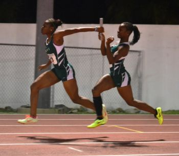 The 4x100m Girls Relay team of Taylor Hill, L'Tsha Fahie, Judine Lacey and Tarika Moses set a new National Junior record with a time of 46.62 seconds. Photo: Charlie E. Jackson/VINO