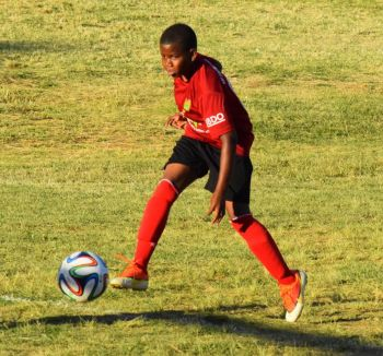 Johari Lacey keeping ASPS alive with his goal scoring in the U12's. Photo: Charlie E. Jackson/VINO