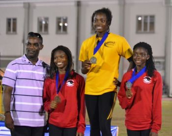 Taylor Hill, Nelda Huggins and L'Tsha Fahie display their medals. Photo: Charlie E. Jackson/VINO