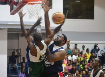 A lone Bayside Blazers player going up against two Knights defenders. Photo: Charlie E. Jackson/VINO