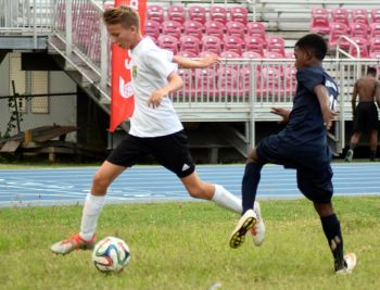 Luca Reich (white top) scored for Cedar School in their 2-0 win over Begrado Flax U14. Photo: Charlie E. Jackson/VINO