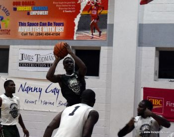 Ray D. Victor freely takes a jumper as three Bayside Blazers players look on. Photo: Charlie E. Jackson/VINO
