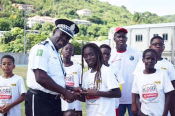Shajahni Duport receives the Best Fielder award from Deputy Police Commissioner, Alwyn James. Photo: BVICA