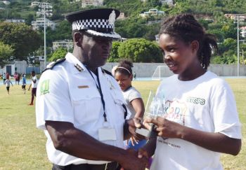 DaMarcus Drego receives the Best Bowler and Tournament MVP Awards from Deputy Police Commissioner, Alwyn James. Photo: BVICA
