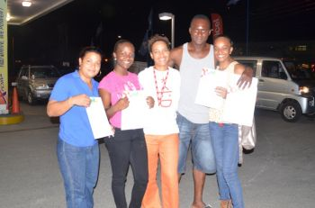 Digicel's Marketing Public Relations Executive, Ms Jasmine Perez (centre) said Digicel's next road show will be held on November 20, 2013 at the frontage of Fine Foods in East End. Photo: Provided