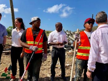 Employees of the RDA, representatives from VI Government and project employees have a talk about the progress at the East End Management Hub in East End, Tortola. Photo: Provided