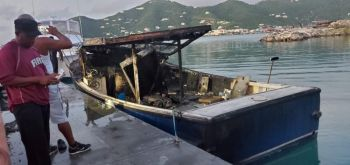 An officer of the Virgin Islands Fire and Rescue Services at the scene of the boat fire today, November 18, 2020. Photo: Team of Reporters