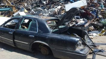 The current system of disposing derelict vehicles is done by private contractors. Photo: VINO