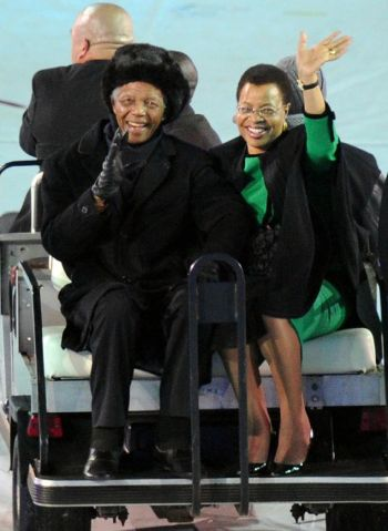 Former South African President Nelson Mandela and his wife, Graca Machel, wave to fans at the World Cup soccer final between the Netherlands and Spain at the First National Bank Stadium in Soweto, South Africa, on July 11, 2010. The stadium is the setting for Mandela's funeral on Tuesday. Photo: FRANCK FIFE
