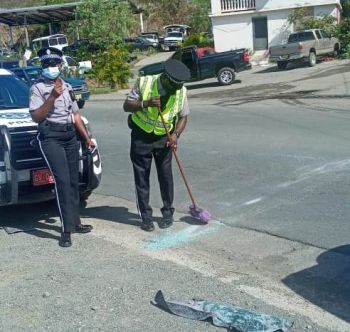 Police on the scene of the accident at Duff's Bottom, Tortola, on March 2, 2021. Photo: Team of Reporters