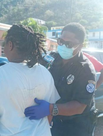 An Emergency Medical Technician (EMT) attends to one of the persons involved in the vehicular accident at Duff's Bottom, Tortola, today, March 2, 2021. Photo: Team of Reporters