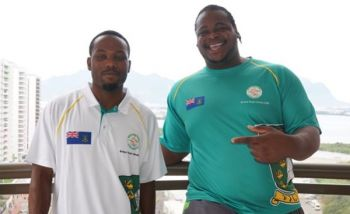 Coach Omar A. Jones with top thrower Eldred Henry at the 2016 Rio Olympic Games. Photo: Provided