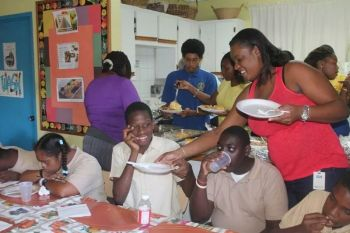 Our Young Professional for this week sharing the Thanksgiving delights with the students of the Eslyn Henley Richez Learning Centre. Photo: Provided