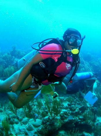 Our Young Professional is a trained marine biologist. Here she is seen doing the things she loves best. Photo: Provided