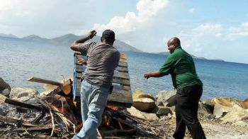 Honourable Andrew A. Fahie, First District Representative and Leader of the Opposition, seen assisting Carrot Bay residents during a clean-up exercise on November 5, 2017. Photo: Facebook