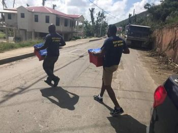 Members of the Rotarian family in action delivering relief items throughout the territory. Photo: Facebook