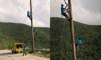 A team of linemen from Jamaica and St Vincent is pictured as they plant poles and run electricity and fiber optic cables in North Sound Virgin Gorda. Photo: Facebook