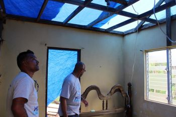 Head of Commercial at Flow, Ravindra Maywahlall assessing Phase 1 of the roof repair works to Mr Leon Creque's home in North Sound Virgin Gorda. The repair works were undertaken as part of the company's Mission Day community service activities. The team will return on November 21 to continue with Phase 2 of the roof repairs. Photo: Flow