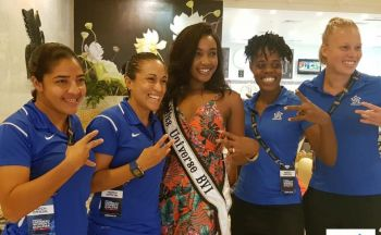 You can take the girl out of the VI, but you can't take the VI out of our girl. Miss BVI A'yana Phillip taught the Confederation of North, Central American and Caribbean Association Football (CONCACAF) referees how to throw up the VI hand sign before she would taking a picture with them. Photo: Provided