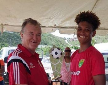 Luka Chalwell, right, receives his MVP award from BVIFA President Mr Andy Bickerton. Photo: Facebook