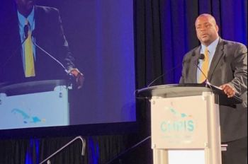 Premier and Minister of Finance, Honourable Andrew A. Fahie (R1) presenting on the territory's tourism products before hundreds of investors and high level stakeholders at the Summit. Photo: GIS