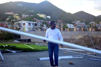 FIFA's African and Caribbean Regional Director, Mr Veron Mosengo-Omba, seen her assisting in cleanup at the FIFA facility in East End on October 13, 2017, was horrified at the damage to the FIFA facilities in the Virgin Islands by hurricane Irma. Photo: Charlie E. Jackson/VINO