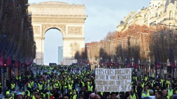 Protesters were able to march some distance along the Champs-Elysées. Photo: BBC News