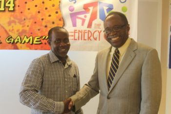 Bishop John I. Cline (left) and Hon Julian Fraser RA (R3) greet each other at the launch of the 2014 Hon Julian Fraser/Save the Seed Basketball League tournament on July 7, 2014. Photo: VINO/File