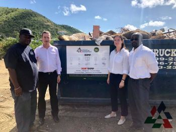 Contract Awardee Mr Lance Thomas of LMJ's Backhoe and Trucking Service, RDA CEO Mr Paul Bayly, Project Manager Helen Haigh and Head of DWM Mr Greg Massicot visit one of 24 special bins placed around Tortola for use by residents to dispose of refrigerators, ranges, windows, doors, furniture, washers, dryers, mattresses, electrical appliances and roofing material. Photo: Provided